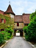 Archway over a street in the village of Autoire, France. Picturesque archway over a street in the beautiful village of Autoire, France Royalty Free Stock Photo