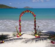 Archway in paradise. Archway decorated with colorful flowers on a caribbean beach Royalty Free Stock Images