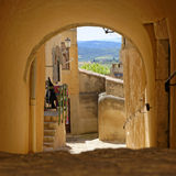 Archway in Provence. A stone archway in a town in Provence, France Royalty Free Stock Photo
