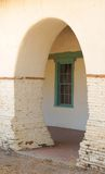 Archway at the San Juan Bautista Mission. With a green window in the background Royalty Free Stock Photos