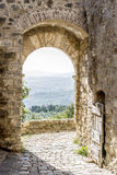 Archway in San Quirico. With view to the Tuscan landscape in Tuscany, Italy Royalty Free Stock Images