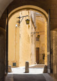 Archway in a street of Mdina Royalty Free Stock Photography