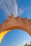 Archway to Heaven. Sunset highlights a masonry archway at Mission San Xavier, near Tucson, Arizona royalty free stock photo