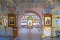 Archway to iconostasis through halls of worship in church Stock Photo