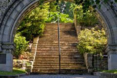 Archway to sunlit stairs Stock Images