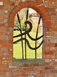 Archway with wrought iron design Royalty Free Stock Photo
