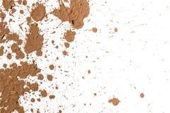 Arcilla de la textura que se mueve en el fondo blanco. Fotografía de archivo libre de regalías