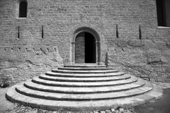 Arcing steps. Circular steps to an entrance to an old church Stock Photo