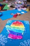 Arco-íris com stampers do floco de neve e colagem molhada na luva imagens de stock