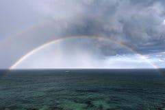Arco-íris e mar Fotografia de Stock