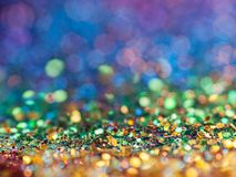Arco-íris Glittery Bokeh do fundo da faísca foto de stock