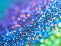 Arco-íris Glittery Bokeh do fundo da faísca imagens de stock royalty free