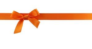 Arco arancione del regalo Fotografia Stock Libera da Diritti