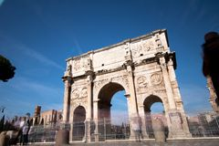 Arco of Costantino in Rome. Costantine arch of triumph in Rome w. Ith tourist moving fast around it Stock Photo