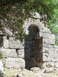 Arco de la ciudad antigua de Olympos Foto de archivo libre de regalías
