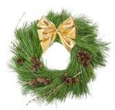 Arco de oro de la cinta de los conos del pino de la guirnalda de la Navidad Imágenes de archivo libres de regalías