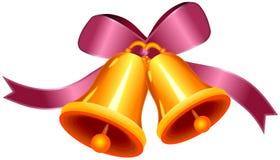 Arco decorativo con due campane dorate Fotografia Stock