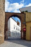 Arco del Cubo and tower of the Church of the Candelaria. The arc Arco del Cubo (17th century), corresponds to the northern gate outside of the town of Zafra. In Stock Photography