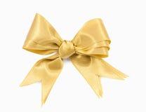 Arco del doppio del nastro dell'oro sulla preparazione bianca del fondo per il regalo immagini stock