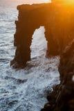 Arco del mar de Holei en la puesta del sol Imagen de archivo libre de regalías