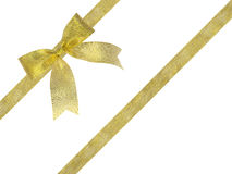 Arco del nastro dell'oro isolato su fondo bianco, paht di taglio compreso Fotografia Stock Libera da Diritti