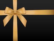Arco del oro con las cintas Cinta de satén brillante del oro del día de fiesta en negro Imagen de archivo