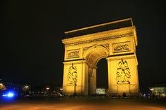Arco del Triunfo de létoile por el tiro de la noche, París, Francia Fotos de archivo