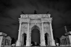Arch of peace monument in the night. Arco della Pace view from the back side black and white photo stock photo