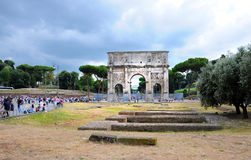 Arco di Constantino. The Arch of Constantine,  Arco di Constantino,  is a triumphal arch in Rome, situated between the Colosseum and the Palatine Hill.It is one Stock Photos