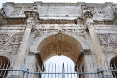 Arco di Constantino. The Arch of Constantine,  Arco di Constantino,  is a triumphal arch in Rome, situated between the Colosseum and the Palatine Hill.It is one Royalty Free Stock Image