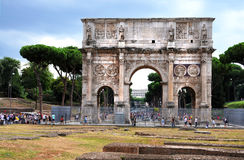 Arco di Constantino. The Arch of Constantine,  Arco di Constantino,  is a triumphal arch in Rome, situated between the Colosseum and the Palatine Hill.It is one Stock Images