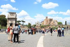 Arco di Costantino and The Temple of Venus and Rome. Tourists walking around Arco di Costantino - Constantin´s Arch in front of The Temple of Venus and Rome Royalty Free Stock Image