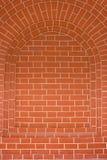 Arco do tijolo como o fundo Imagens de Stock
