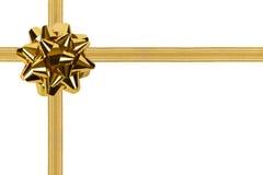 Arco e nastro dell'oro Immagine Stock