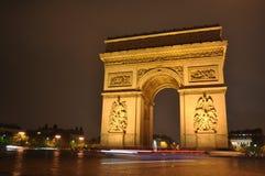 Arco en la noche, París Francia del triunfo Fotografía de archivo