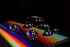Arco iris CD y Waterdrops Imagen de archivo libre de regalías