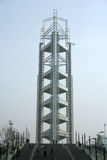 Arco iris de luces en la torre olímpica Pekín Fotos de archivo