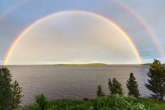 Arco iris doble sobre el lago Imagen de archivo libre de regalías