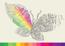Arco iris en el ala de una mariposa. Fotos de archivo