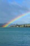 Arco iris en el cielo y sobre el mar Imagen de archivo libre de regalías