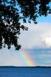 Arco iris en el lago Foto de archivo libre de regalías