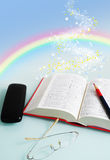 Arco iris en libro Imagenes de archivo