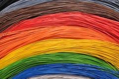 Arco iris en redes de banda ancha Fotos de archivo libres de regalías