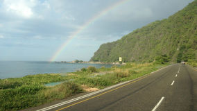 Arco iris entre la llovizna Fotografía de archivo