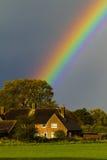Arco iris sobre casa Fotos de archivo