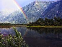 Arco iris sobre The Creek Imagenes de archivo