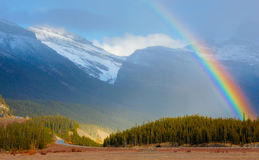 Arco iris sobre el glaciar Imágenes de archivo libres de regalías