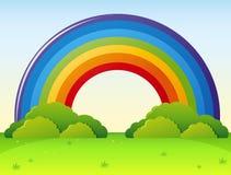 Arco iris sobre el parque verde ilustración del vector