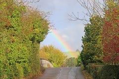 Arco iris sobre un camino Fotografía de archivo