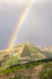 Arco iris y montañas rocosas Foto de archivo libre de regalías